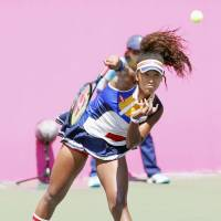 Naomi Osaka hits a shot during her match against Kurumi Nara on Wednesday at the Japan Women's Open. | KYODO
