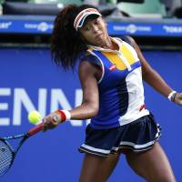 Naomi Osaka plays a shot during her first-round loss to Germany's Angelique Kerber at the Pan Pacific Open in Tokyo on Monday. | AP