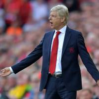 Arsenal's Arsene Wenger is under fire from the team's fans early in the new Premier League season. | AFP-JIJI