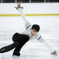Yuzuru Hanyu performs his free skate program at the Autumn Classic on Saturday in Montreal. Hanyu finished the event in second place behind Javier Fernandez. | KYODO