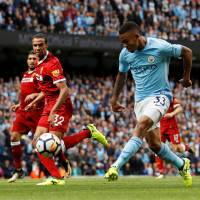 Manchester City turns on style to trash Liverpool