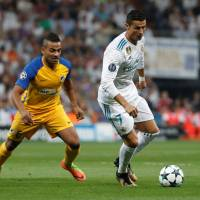Real Madrid's Cristiano Ronaldo moves the ball in front of APOEL Nicosia's Lorenzo Ebecilio in Champions League action on Wednesday night in Madrid. Real Madrid won 3-0. | REUTERS