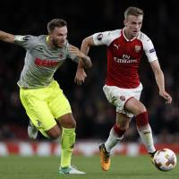 Arsenal rallies past Cologne; Silva has hat trick for Milan
