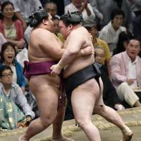 Goeido forces out Mitakeumi on the 11th of the Autumn Grand Sumo Tournament on Wednesday. | KYODO