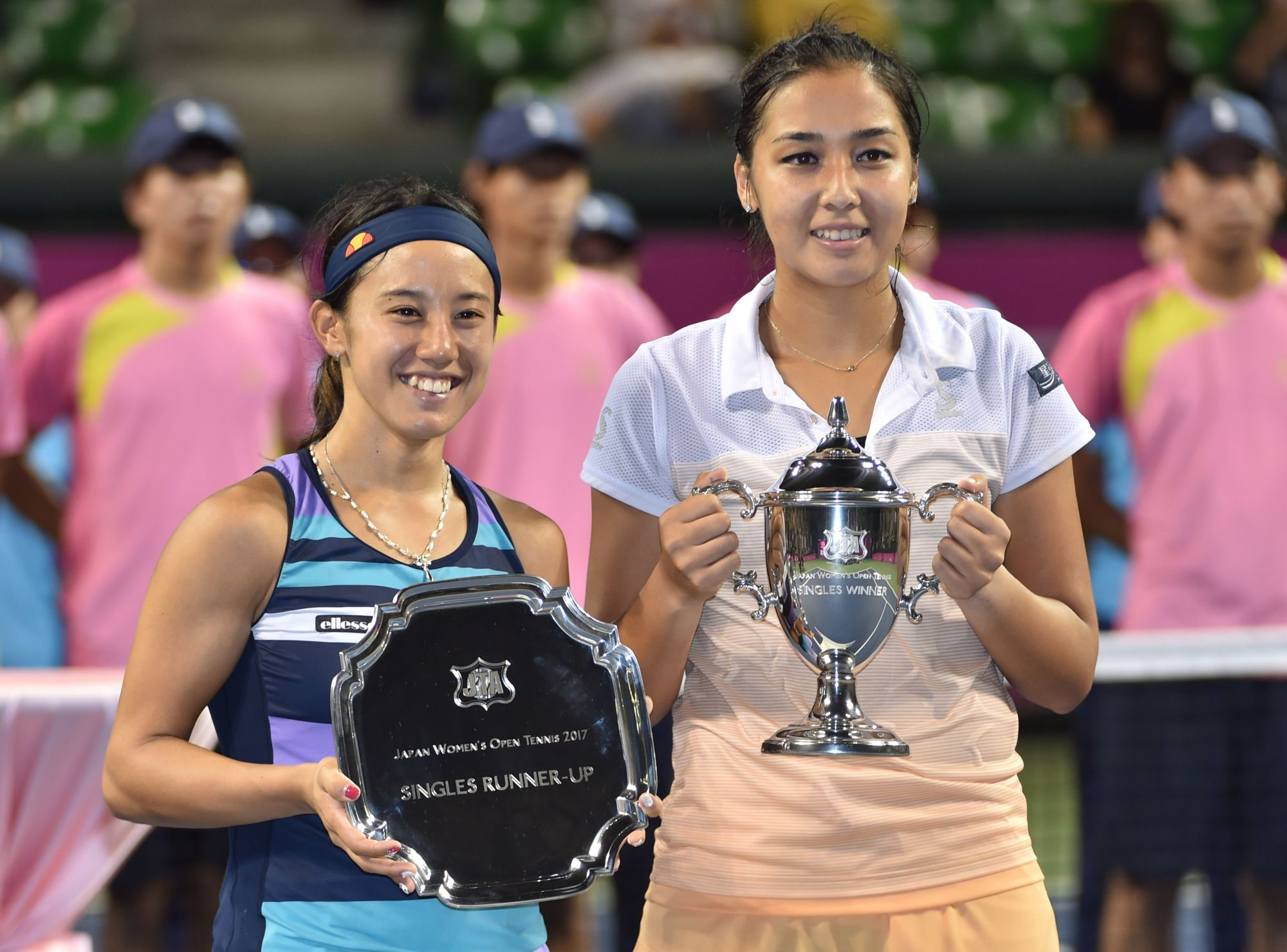 Japan Women's Open champion Zarina Diyas (right) and runner-up Miyu Kato pose with their trophies after Sunday's final at Ariake Coliseum. | AFP-JIJI