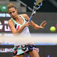 Karolina Pliskova plays a shot during her match against Magda Linette at the Pan Pacific Open on Wednesday. | AFP-JIJI