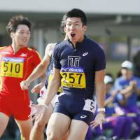 Yoshihide Kiryu reacts after winning the 100 meters in 9.98 seconds at an intercollegiate meet in Fukui on Saturday. | KYODO