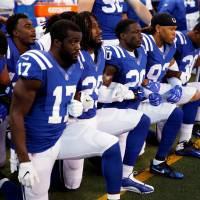 Indianapolis Colts players kneel during the playing of the National Anthem before the game against the Cleveland Browns at Lucas Oil Stadium Sunday in Indianapolis.   BRIAN SPURLOCK-USA TODAY SPORTS / FILE PHOTO