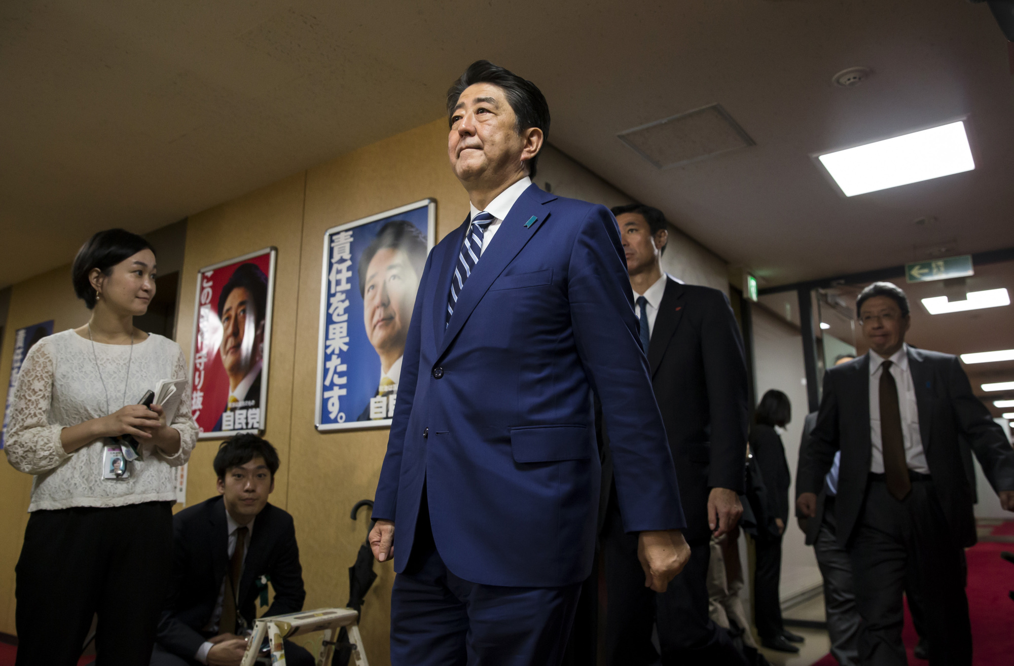 Emboldened by the victory of his ruling coalition in Sunday's general election, Prime Minister Shinzo Abe is likely to boost government spending to speed up his Abenomics deflation-fighting economic policy mix. | BLOOMBERG