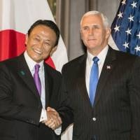 Deputy Prime Minister Taro Aso and U.S. Vice President Mike Pence meet in Washington on Monday for the second round of high-level economic dialogue between Japan and the United States. | POOL / VIA KYODO