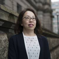 Risa Ueda, head of the commercial banks examination-planning division at the Bank of Japan, poses for a photograph at the BOJ headquarters in Tokyo on Sept. 13. | BLOOMBERG