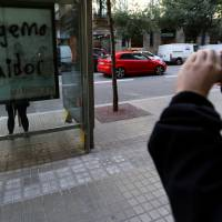 Graffiti reading 'Puigdemont (Catalan President) traitor' is seen on a Barcelona's map at a bus stop in Barcelona, Spain, Monday. | REUTERS
