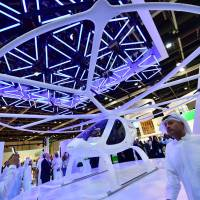 Dubai touts tech prowess, from flying taxis to robocops