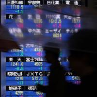 The government said Wednesday in its report for October that Japan's economy is recovering moderately. | AFP-JIJI