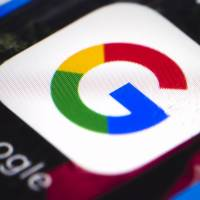 This April photo shows the Google mobile phone icon in Philadelphia. Russian operatives spent tens of thousands of dollars on ads across Google products, including YouTube and Google search, according to reports.  | AP
