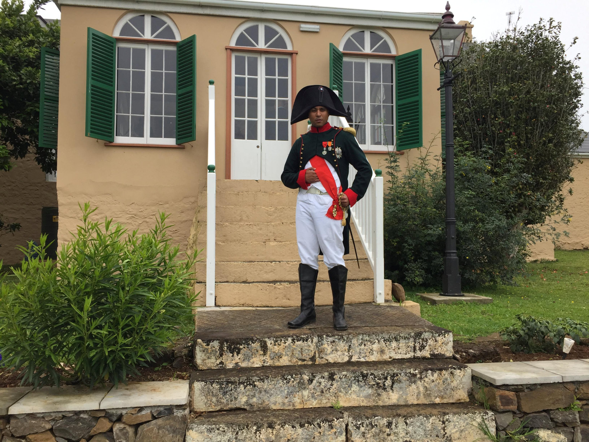 Merrill Joshua, a member of the local government, dresses up as Napoleon outside a house where the exiled French emperor's personal assistant used to live, in Jamestown, on the tiny Atlantic island of St. Helena, Sunday | REUTERS