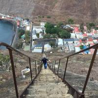 A man walks up stairs above Jamestown, the capital of the tiny Atlantic island of St. Helena, Sunday. | REUTERS