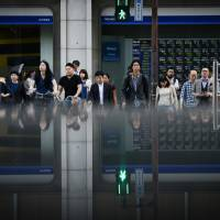 Japanese companies continue to face a severe labor shortage, with job availability remaining at the highest level since February 1974. | BLOOMBERG