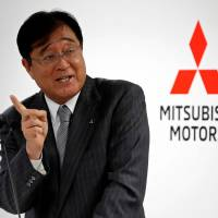Mitsubishi Motors Corp. CEO Osamu Masuko speaks at a news conference at its company headquarters in Tokyo on Wednesday. | REUTERS