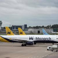 Monarch Airlines aircraft sit on the tarmac at Birmingham Airport in Birmingham, central England, Monday. | AFP-JIJI