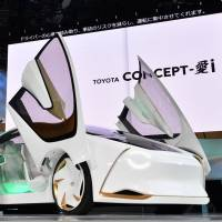 Toyota displays its EV concept car Concept-i, a vehicle equipped with an artificial intelligence system, at a media preview at the Tokyo Motor Show on Wednesday. | YOSHIAKI MIURA
