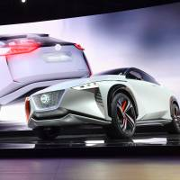 Daniele Schillaci, Nissan Motor Co.'s executive vice president, shows off the automaker's high-end concept EV Nissan IMx during a media preview at the Tokyo Motor Show on Wednesday. | YOSHIAKI MIURA