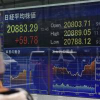Nikkei closes at 21-year high amid global stock rally