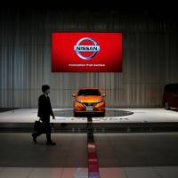A man walks in the Yokohama showroom of Nissan Motor Co., which has been rocked by a scandal over flawed product inspections. | REUTERS