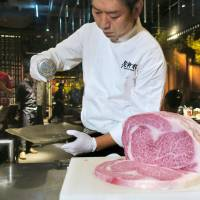 A chef prepares imported Miyazaki beef at a restaurant in Taipei on Saturday. The meat was part of the first beef shipment from Japan in 16 years after Taiwan lifted its 2001 import ban, which was triggered by an outbreak of mad cow disease. | KYODO