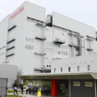 Toshiba Corp.'s semiconductor plant in the city of Yokkaichi in Mie Prefecture is seen in this photo taken last month. KYODO