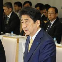 Prime Minister Shinzo Abe speaks Thursday at the start of a government panel meeting at his office in Tokyo. | KYODO