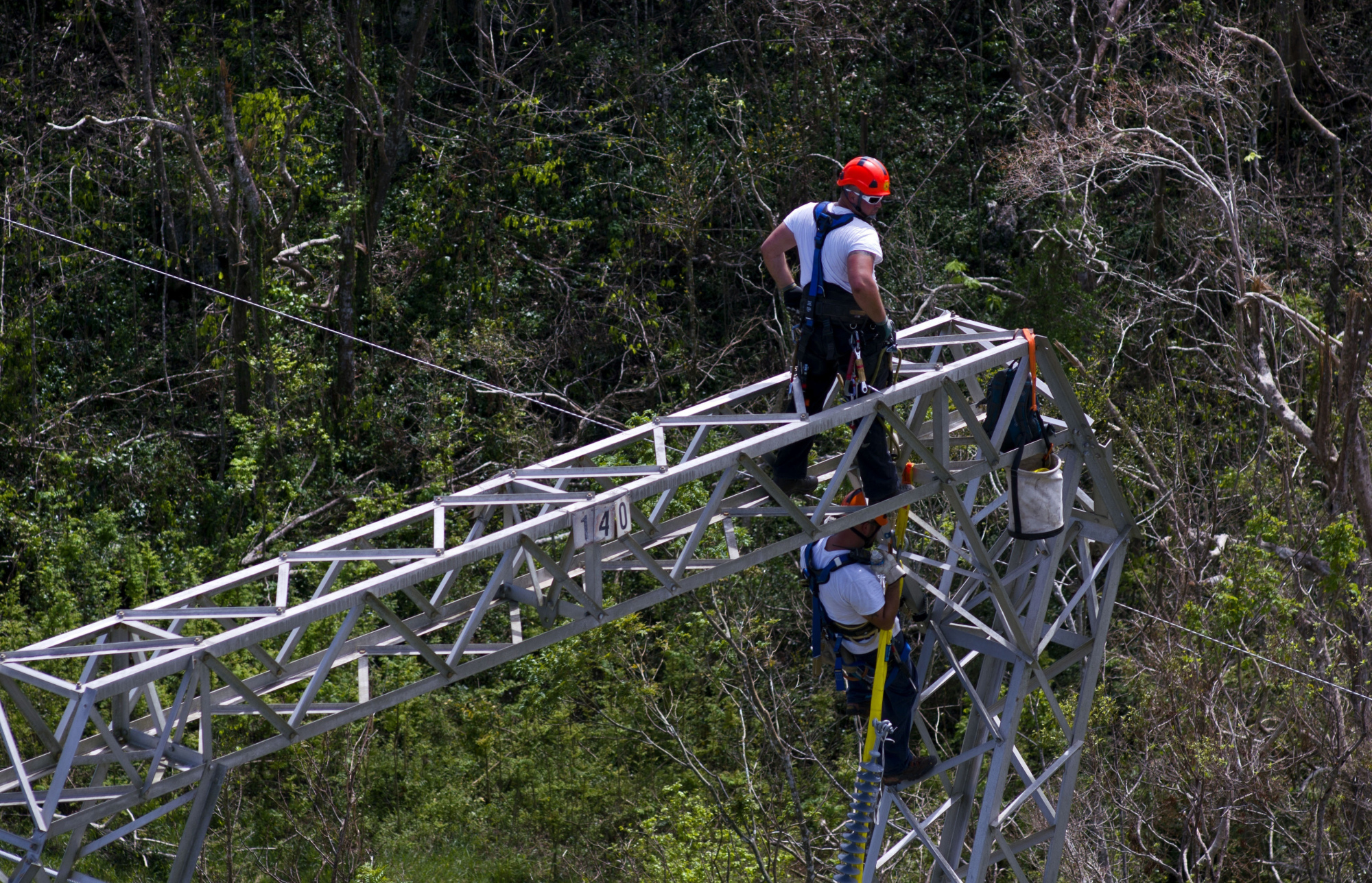 Whitefish Energy Holdings workers restore power lines damaged by Hurricane Maria in Barceloneta, Puerto Rico, Oct. 15. The Federal Emergency Management Agency said Friday it had no involvement in the decision to award a $300 million contract to help restore Puerto Rico's power grid to a tiny Montana company in Interior Secretary Ryan Zinke's hometown. | AP