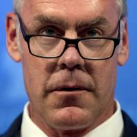 Interior Secretary Ryan Zinke speaks on the Trump Administration's energy policy at the Heritage Foundation in Washington in September. The Trump administration said Friday it had no involvement in the decision to award a $300 million contract to help restore Puerto Rico's power grid to a tiny Montana company in Zinke's hometown. | AP