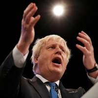British Foreign Secretary Boris Johnson addresses the Conservative Party conference in Manchester, England, on Tuesday. | REUTERS