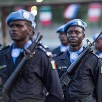 The Cameroon garrison stands at attention during the official closing ceremony of the United Nations Stabilization Mission in Haiti in Tabarre on Thursday. | AFP-JIJI