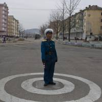 A North Korean traffic policeman stands at an intersection in Kaesong, North Korea, in April 2013.   AP