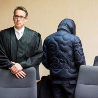 Former secret agent Werner Mauss (right) stands next to his lawyer, Daniel Fischer, at the start of a session of his trial in Bochum, Germany, on Thursday.   DPA / VIA AFP-JIJI