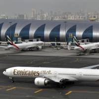 An Emirates plane taxis to a gate at Dubai International Airport. The long-haul carrier says it is starting new screening procedures for U.S.-bound passengers following 'new security guidelines' from American authorities. | AP