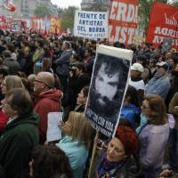 Argentines march en masse to demand answers in case of missing activist believed seized by security forces