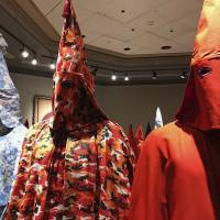 KKK robes are on display Sept. 21 as part of Baltimore artist Paul Rucker's installation titled 'Rewind,' now installed at York College's Wolf Hall in York, Pennsylvania. The college barred the public from seeing the art exhibition on slavery, white supremacy and racist violence against blacks, deeming it 'potentially disturbing to some.' | IVEY DEJESUS / PENNLIVE.COM / VIA AP