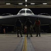 Airmen inspect a B-2 bomber before it takes off Saturday from Whiteman Air Force Base in Missouri for a long-range mission to the U.S. military's Pacific area of responsibility over the weekend. | U.S. AIR FORCE