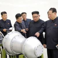 North Korean leader Kim Jong Un visits a nuclear weapons site in this photo released on Sept. 3. State-run media said Kim inspected the loading of a hydrogen bomb onto a new ICBM. | AP