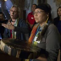 Surrounded by aboriginal chief Marcia Brown Martel (front) and 'Sixties Scoop' survivors, Indigenous Relations Minister Carolyn Bennett responds to a question during a news conference on Parliament Hill, in Ottawa on Friday. | THE CANADIAN PRESS / VIA AP