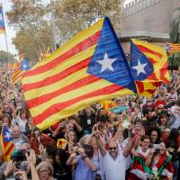 Spain on a knife's edge as Madrid seizes control of rebel Catalonia