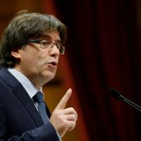 Catalonia President Carles Puigdemont speaks during a session of the regional parliament in Barcelona, Spain, on Sept. 28. | REUTERS