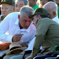 Cuban President Raul Castro (right) talks with First Vice President Miguel Diaz Canel during the homage for the 50th anniversary of Ernesto 'Che' Guevara's death, in Santa Clara, Cuba, on Sunday. | AFP-JIJI