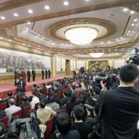 China says foreign press welcome even as some media outlets excluded from key event