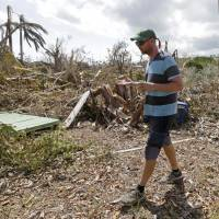 Patrick Garvey walks on what's left of his farm as he talks to a reporter about by the destruction of his once-thriving enterprise, called The Grimal Grove, by Hurricane Irma, in Big Pine Key, Florida, Sept. 14. A new poll by the Associated Press-NORC Center for Public Affairs Research says 68 percent of those surveyed think weather disasters seem to be worsening, compared to 28 percent who think they are staying the same and only 4 percent who say they are less severe. | AP