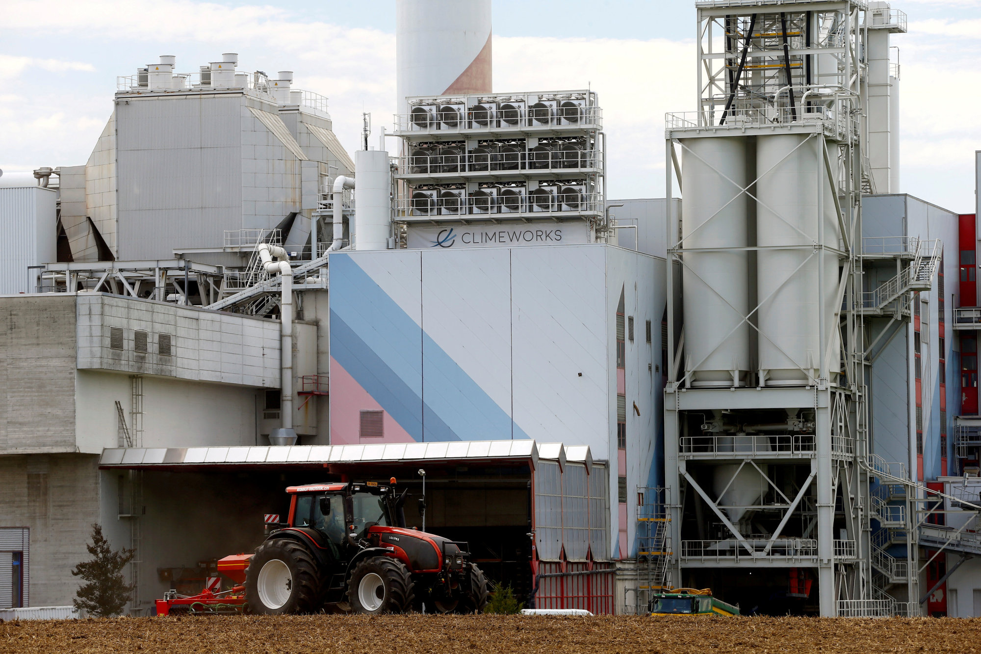 A Climeworks facility for capturing carbon dioxide stands on the roof of a waste incineration plant in Hinwil, Switzerland, on July 18. | REUTERS