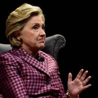 Former U.S. Secretary of State, Hillary Clinton speaks during an interview with Mariella Frostrup at the Cheltenham Literature Festival in Cheltenham, Britain, Sunday. | REUTERS